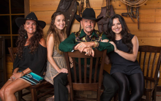 Image of Ron Bergeron and his three daughters