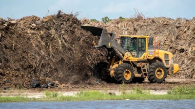 Bulldozer pushing mounds of debris